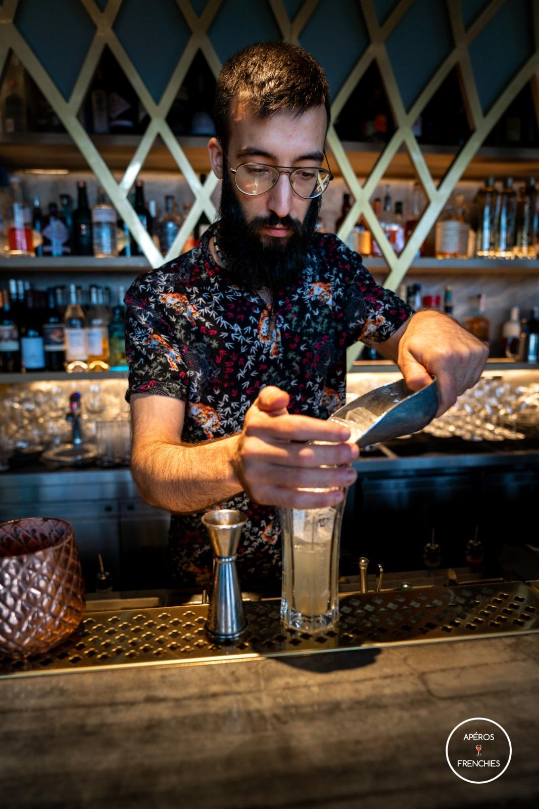Bartender mixing St Germain
